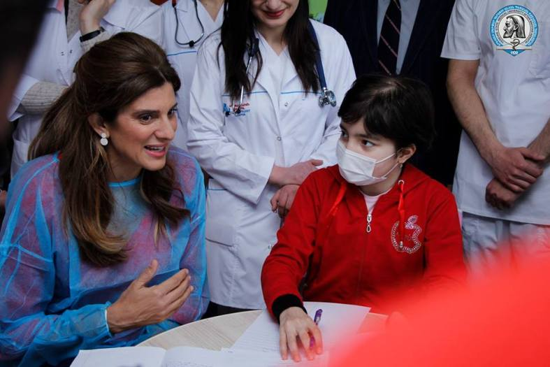 Princess Dina with patients